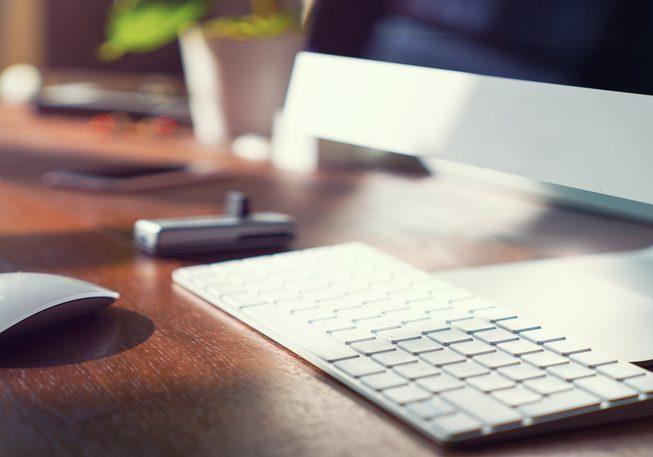 Computer on desktop in office